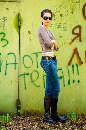 girl against a wall with photo