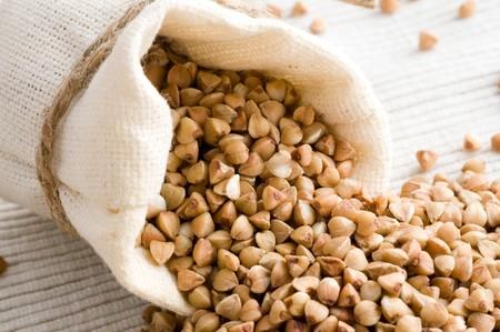 raw buckwheat in small sack Stock Photo - 4093671