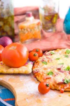 cheese and tomato pizza with rocket photo