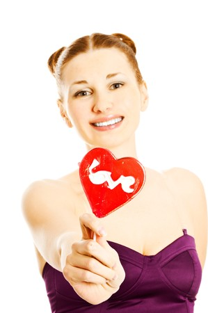 woman portrait with heart shaped lollipops  photo