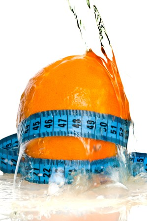 fresh oranges with a measuring tape photo
