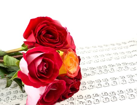 sheetmusic: Red rose on note sheet