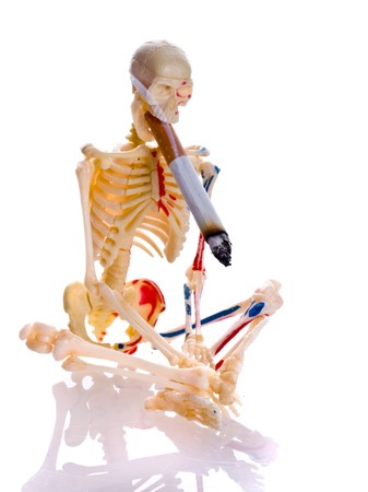 lung disease: Cigarette and skeleton. Isolation on the white