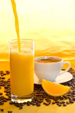 Orange juice, coffee grains and coffee. photo