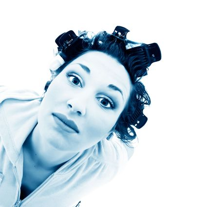 untangle: girl in hair curlers. Isolation on the white
