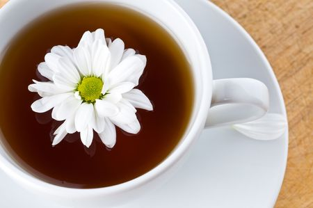 Natural tea with a camomile and flower Stock Photo - 4701105