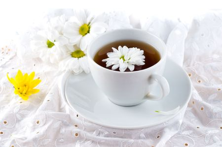 Natural tea with a camomile and flower photo