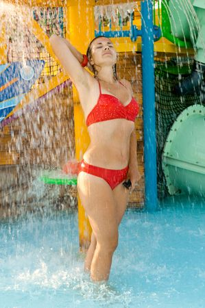 sexual activities: girl in a bathing suit under a shower Stock Photo