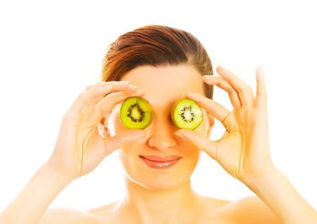 womans: beautiful woman`s face with kiwi  Stock Photo