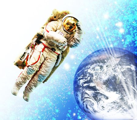 cosmonaut flying to the earth Stock Photo - 4808609