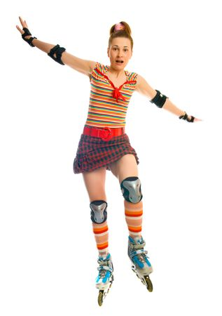 roller skate: beautiful young woman on the roller fads. Isolation on the white Stock Photo
