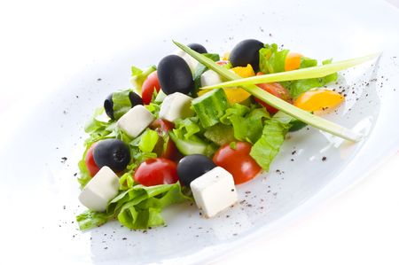 Greek salad. Isolation on the white Stock Photo