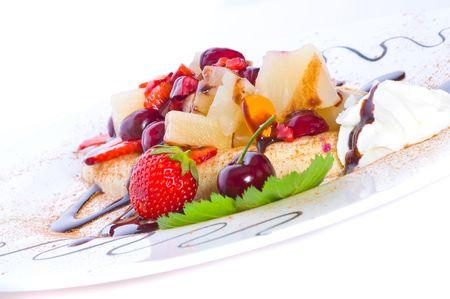Fruit salad with ice-cream and banana.