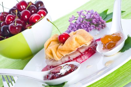 Fritters with sweet cherry and sirop photo