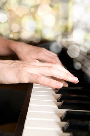 piano lesson: hands of a piano player