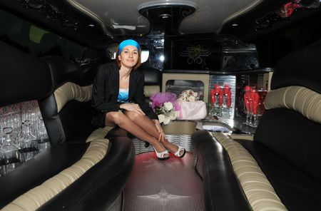 beautiful woman in a limousine photo