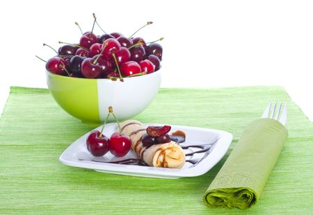 Fritters with sweet cherry on green Stock Photo - 5374941