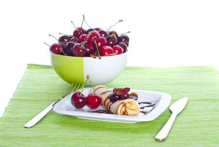 bign�: Frittelle con le ciliegie dolci, sul verde