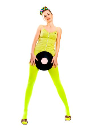 Disco girl with vinyl on green  photo