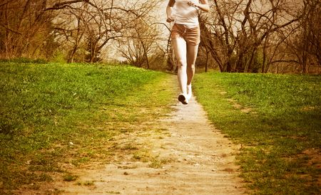 young woman runner in a green forest.  photo