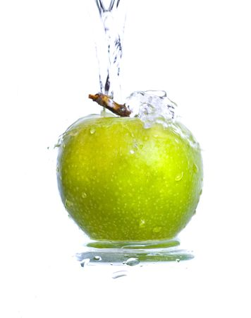 Fresh apple jumping into water with a splash  photo