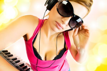 beautiful sexual woman in headphones photo