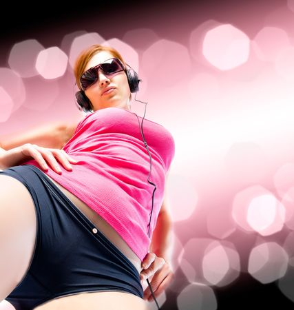 nodding: beautiful sexual woman in headphones