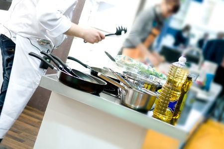 prepared dish: Chef hands add vegetables on a frying pan on professional kitchen