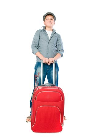 teenager with a suitcase. Isolation on the white  photo