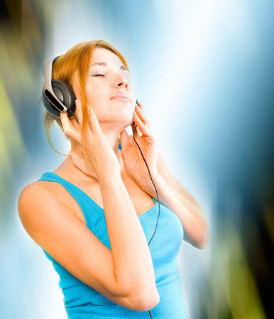 fiestas electronicas: hermosa mujer sexual en auriculares Foto de archivo