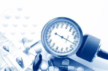 medical report. sphygmomanometer and pills Stock Photo - 6089295