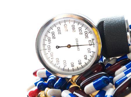 medical report. sphygmomanometer and pills Stock Photo - 6089260