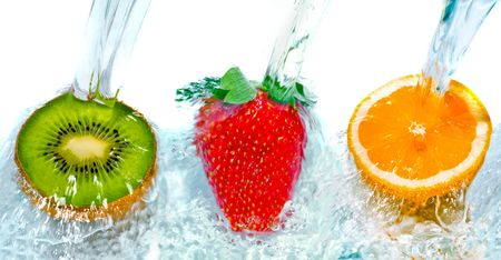 Fresh fruit jumping into water with a splash photo