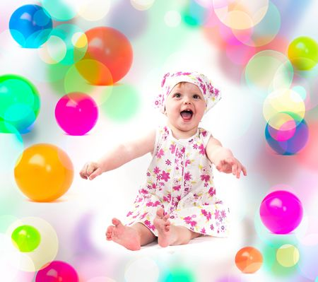 baby playing with colorful balloons photo
