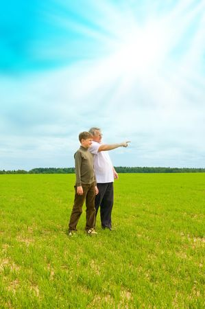 grandson and grandfather in the field photo