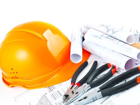 Building projects with architect drawing and protective tools photo