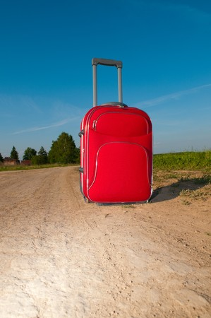 Suitcase on road infield Stock Photo - 7083481