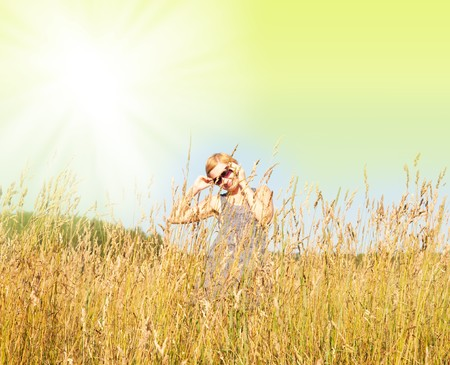Happy young woman in the field photo