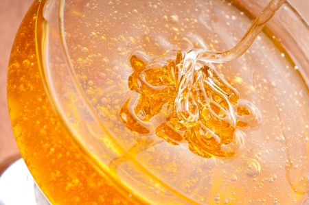 fresh gold honey dipper. macro photo