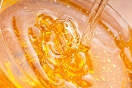raw gold: fresh gold honey dipper. macro