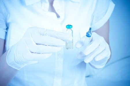ampoule in a hand photo