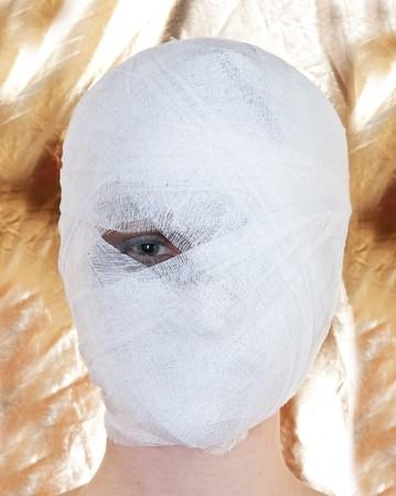 plastic wrap: beautiful woman with bandage on head. Stock Photo