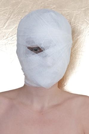 beautiful woman with bandage on head. photo