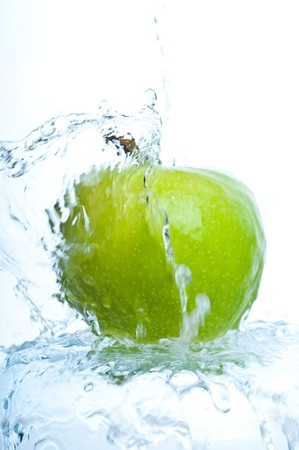 apple  into water splash on white photo