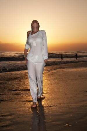 woman running at the beach photo