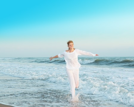 woman running at the beach