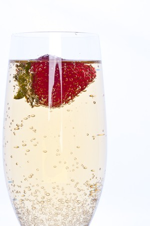 fresh strawberry floating in glass of champagne photo