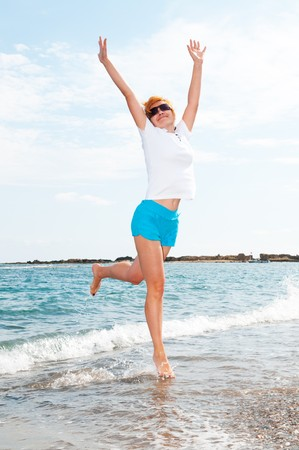 young woman jump on sea. Stock Photo - 8047403
