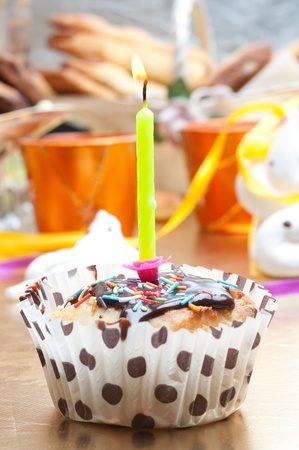 cupcake with sprinkles and candle. birthday photo