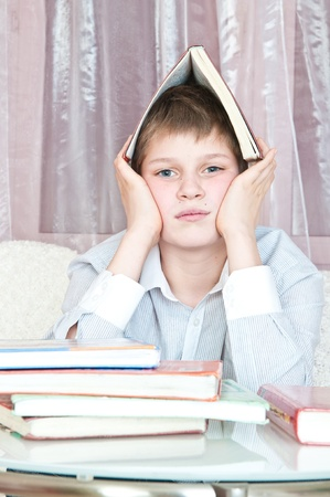 pupil sits at  table with books Stock Photo - 8647562
